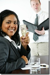 bigstockphoto_Businesswoman_With_Money_3339008